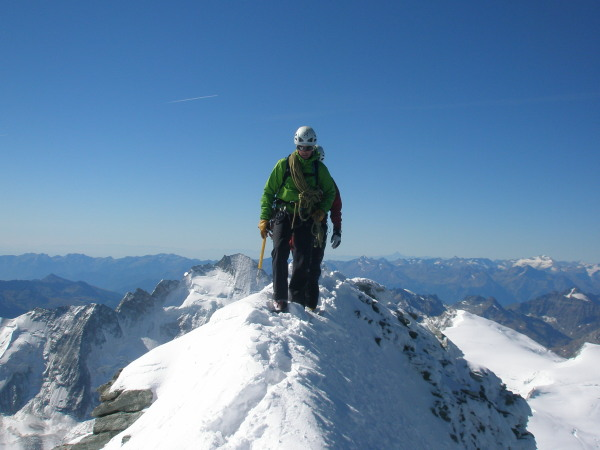 Aspirant guide James Thacker reaches the top